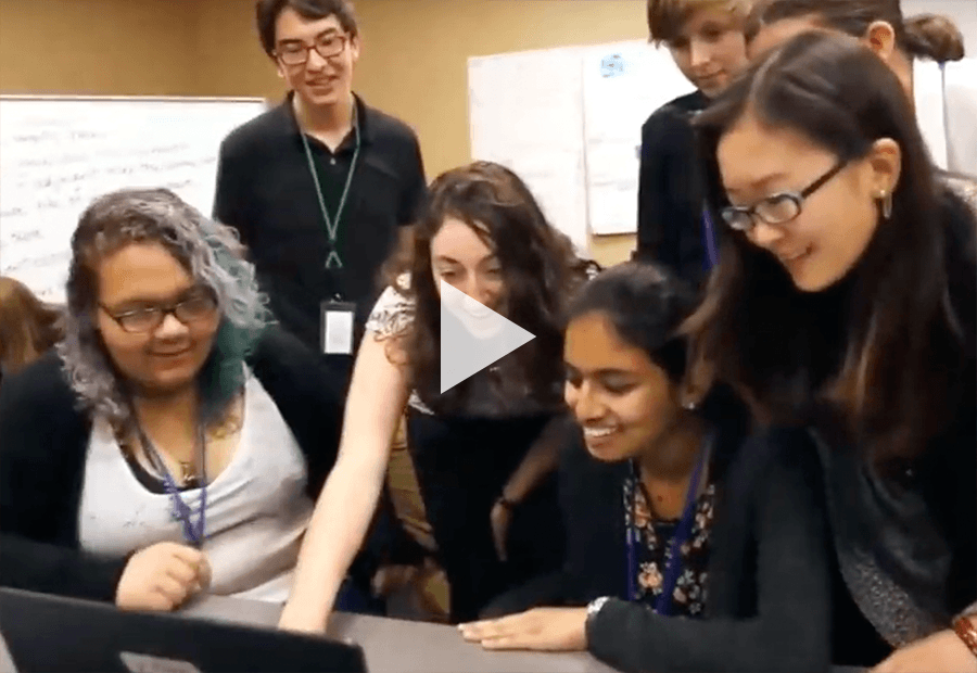 a group of ladies in front of a laptop