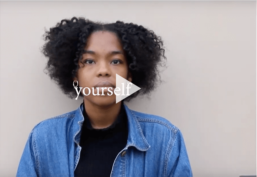 African American teen looking straight at camera